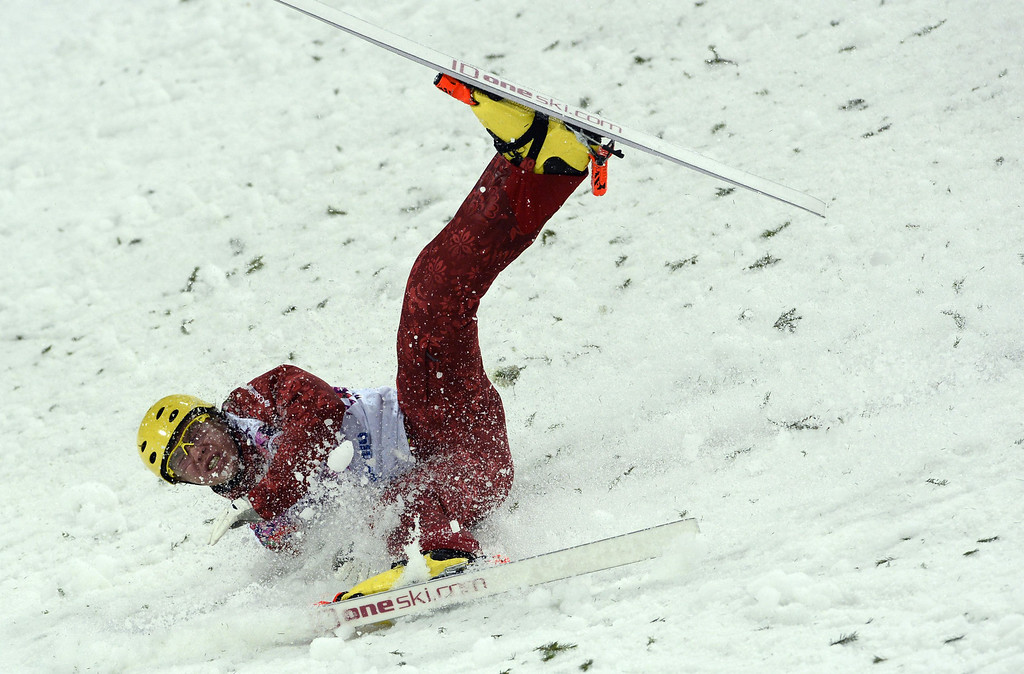 . Russia\'s Pavel Krotov crashes as he competes in the Men\'s Freestyle Skiing Aerials finals at the Rosa Khutor Extreme Park during the Sochi Winter Olympics on February 17, 2014.  FRANCK FIFE/AFP/Getty Images