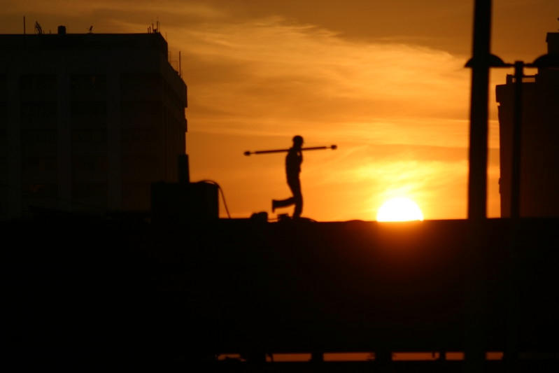 House builder in the sunset, New Delhi
