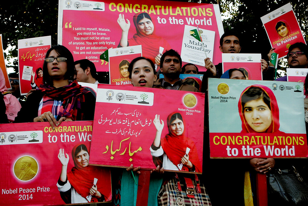 . Pakistani students pay tribute to Nobel Peace Prize laureate Malala Yousafzai in Lahore, Pakistan, Wednesday, Dec. 10, 2014. Malala\'s struggle for girls to be educated in a deeply conservative society led to a shooting against her by the Taliban two years ago. Malala and Kailash Satyarthi of India have received the Nobel Peace Prize for risking their lives to fight for children\'s rights. (AP Photo/K.M. Chaudary)