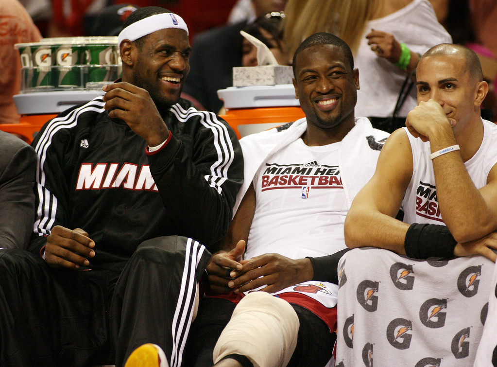 . The Miami Heat\'s LeBron James, Dwyane Wade and Carlos Arroyo share a smile against the Minnesota Timberwolves  during the closing seconds of the fourth quarter of an NBA basketball game in Miami, Tuesday , Nov. 2, 2010.(AP Photo/Jeffrey M. Boan)
