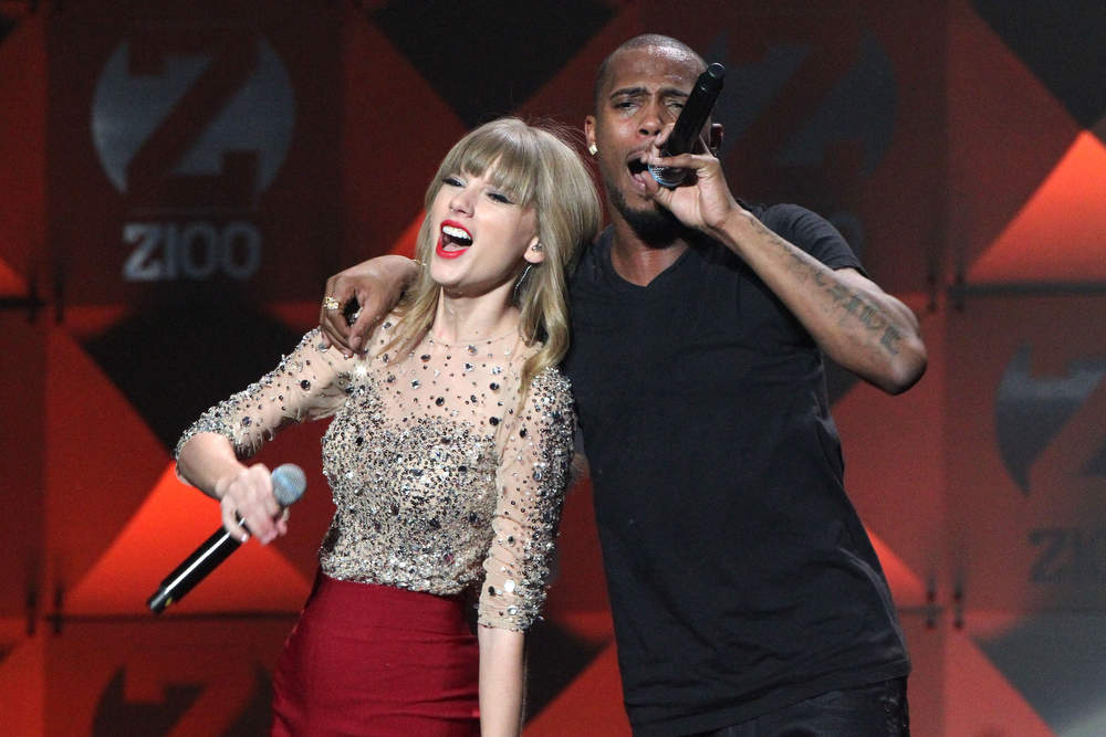 . Taylor Swift and Hip Hop artist B.o.B. perform onstage during Z100\'s Jingle Ball 2012, presented by Aeropostale, at Madison Square Garden on December 7, 2012 in New York City.  (Photo by Kevin Kane/Getty Images for Jingle Ball 2012)