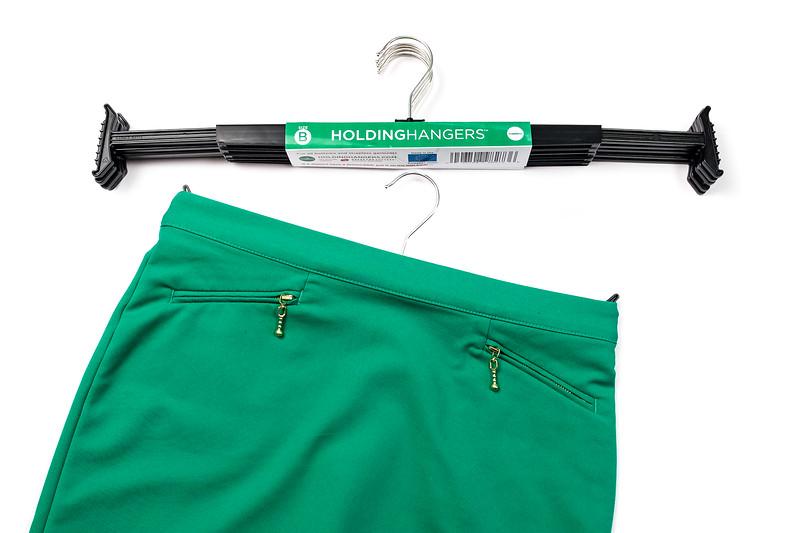 holding hangers green skirt.jpg
