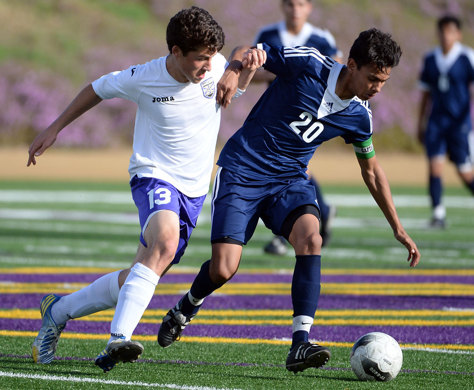 . Baldwin Park\'s Danny Vega (20) fights for the ball with Diamond Bar\'s Anthony Vazquez (13) in the first half of a CIF-SS quarterfinal prep playoff soccer match at Diamond Bar High School in Diamond Bar, Calif., on Thursday, Feb.27, 2014. Baldwin Park won 2-1. (Keith Birmingham Pasadena Star-News)