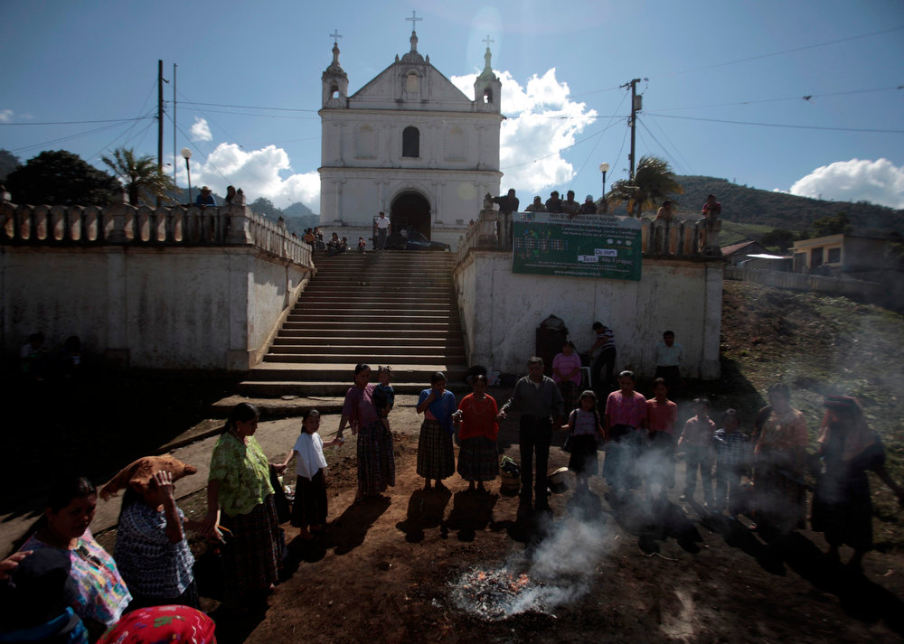 ". Indigenous people participate in the pre-Hispanic mass of ""Primera Conexion\"" and \""Sincronizacion Espiritual\"" (First Connection and Spiritual Synchronization), to commemorate the 13th Baktun, outside the Chi Ixim church in Tactic, Alta Verapaz region of Guatemala on December 20, 2012. This week, at sunrise on Friday, December 21, an era closes in the Maya Long Count calendar, an event that has been likened by different groups to the end of days, the start of a new, more spiritual age or a good reason to hang out at old Maya temples across Mexico and Central America. The Chi Ixim church is a sacred Mayan site.  REUTERS/Jorge Dan Lopez"