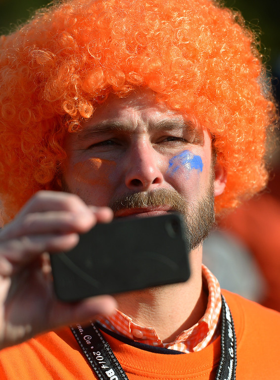 . Auburn alumn Brandon Ashby, of New Jersey, takes a picture at an alumni party before the BCS game at the Rose Bowl, Monday, January 6, 2014. (Photo by Michael Owen Baker/L.A. Daily News)