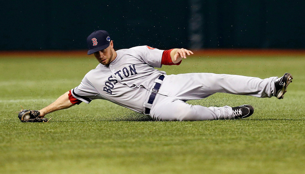 . Boston Red Sox left fielder Daniel Nava catches a fly ball from Tampa Bay Rays\' Matt Joyce in the second inning in Game 3 of an American League baseball division series, Monday, Oct. 7, 2013, in St. Petersburg, Fla. (AP Photo/Mike Carlson)