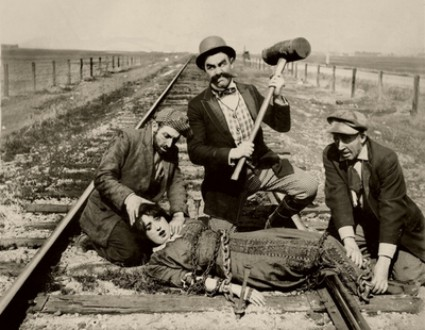 Tied to tracks IMG: Barney Oldfield's Race for a Life (1913), from moma.org