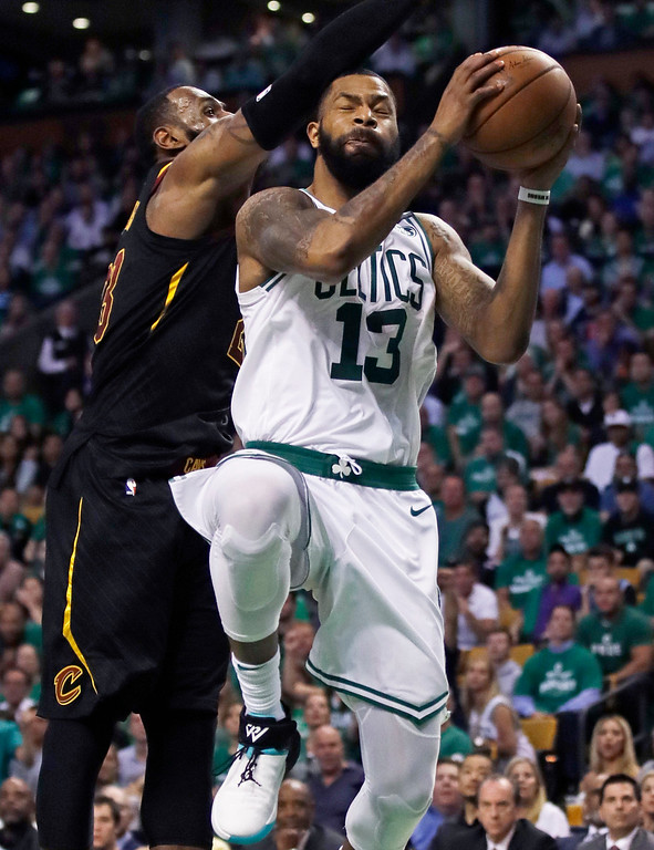 . Boston Celtics forward Marcus Morris (13) goes to the basket against Cleveland Cavaliers forward LeBron James during the third quarter of Game 5 of the NBA basketball Eastern Conference finals Wednesday, May 23, 2018, in Boston. (AP Photo/Charles Krupa)