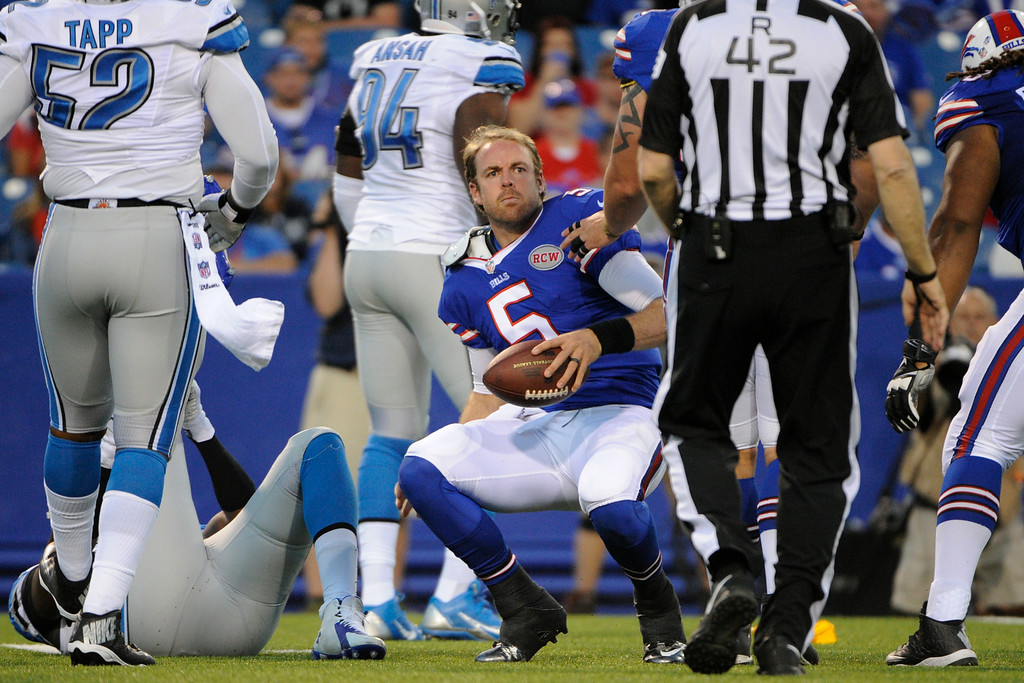 . Buffalo Bills quarterback Jordan Palmer (5) is helped up after being brought down by the Detroit Lions defense during the first half of a preseason NFL football game, Thursday, Aug. 28, 2014, in Orchard Park, N.Y. (AP Photo/Gary Wiepert)