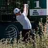 Hunter Mahan hits his drive on the first tee.