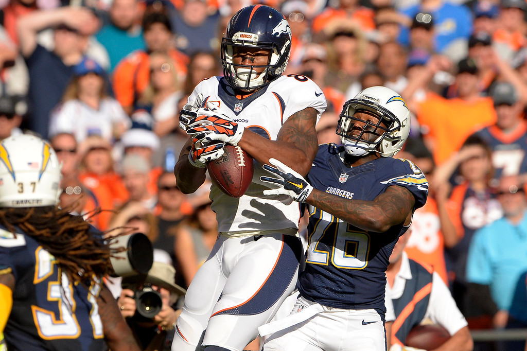 . SAN DIEGO, CA. December 14, - wide receiver Demaryius Thomas #88 of the Denver Broncos pulls in a catch in front of cornerback Brandon Flowers #26 of the San Diego Chargers at Qualcomm Stadium December 14, 2014 San Diego, CA (Photo By Joe Amon/The Denver Post)