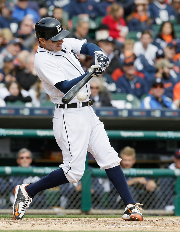 . Detroit Tigers\' Ian Kinsler bats during the seventh inning of an opening day baseball game against the Minnesota Twins in Detroit, Monday, April 6, 2015. (AP Photo/Carlos Osorio)