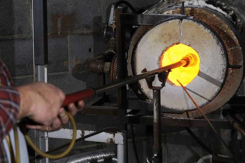Owner Matt Salley demonstrates making a blown glass ornament at Marble City Glassworks in Knoxville, TN on Monday, December 15, 2014. Copyright 2014 Jason Barnette
