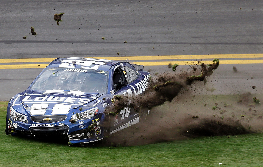 . Jimmie Johnson sends grass flying as he celebrates his win in the Daytona 500 NASCAR Sprint Cup Series auto race, Sunday, Feb. 24, 2013, at Daytona International Speedway in Daytona Beach, Fla. (AP Photo/Chris O\'Meara)