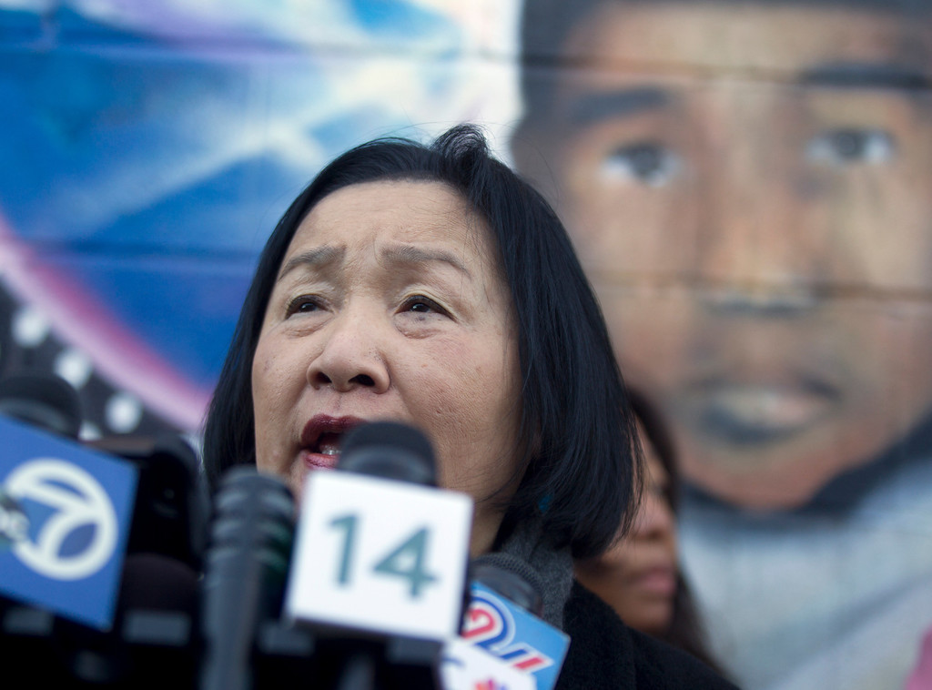 . Beneath a mural depicting Carlos Nava, the 3-year-old boy killed by random gunfire in 2011, Oakland, Calif. Mayor Jean Quan speaks to the media at a press conference to discuss the recent spate of gun violence in the city and the police department\'s proposed response, Monday, Jan. 14, 2013 in Oakland. Police say that ninety percent of the shootings since summer 2012 can be attributed to two warring groups of young men. (D. Ross Cameron/Staff)