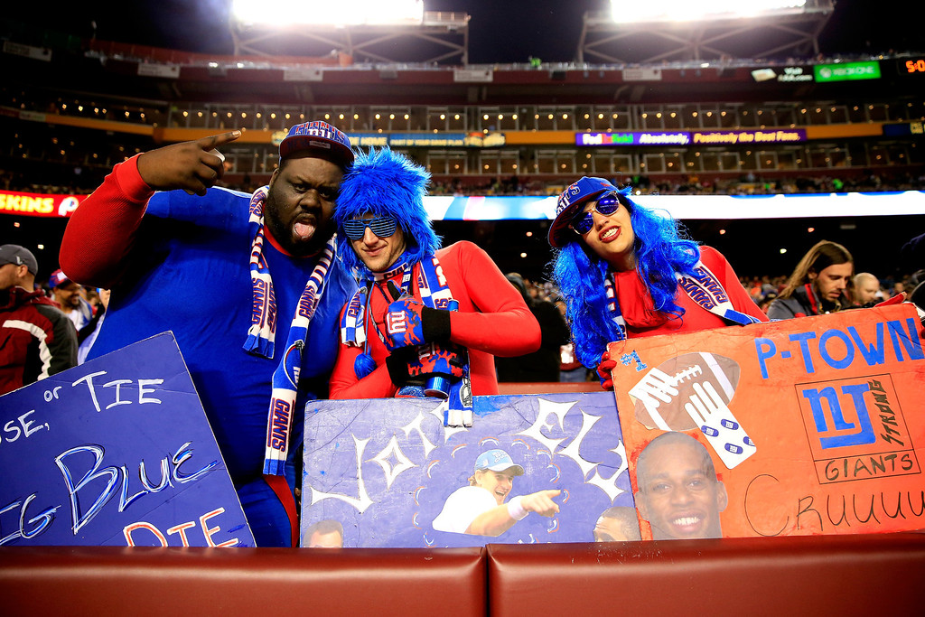 . LANDOVER, MD - DECEMBER 01:  New York Giants fans cheer during the game between the New York Giants and the Washington Redskins at FedExField on December 1, 2013 in Landover, Maryland.  (Photo by Rob Carr/Getty Images)