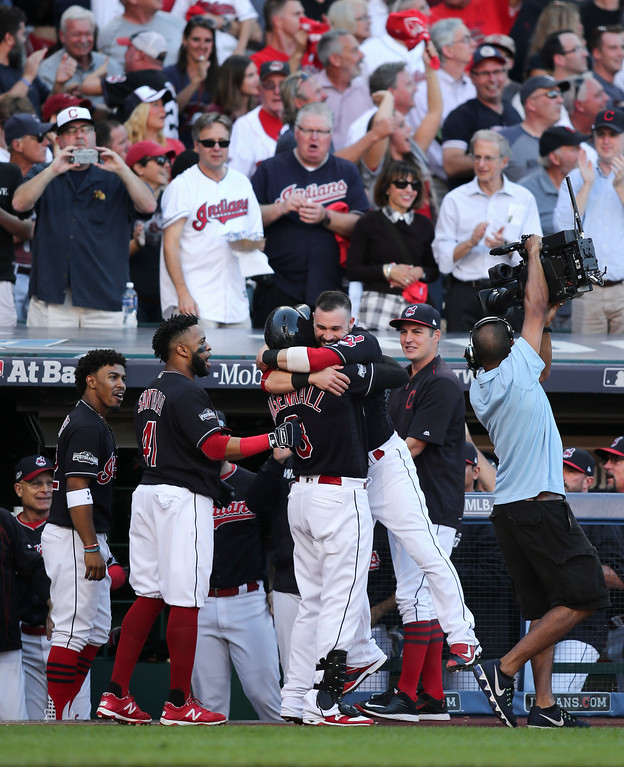 . Cleveland Indians\' Lonnie Chisenhall (8) celebrates with Jason Kipnis after hitting a three-run home run against the Boston Red Sox in the second inning during Game 2 of baseball\'s American League Division Series, Friday, Oct. 7, 2016, in Cleveland. (AP Photo/Aaron Josefczyk)
