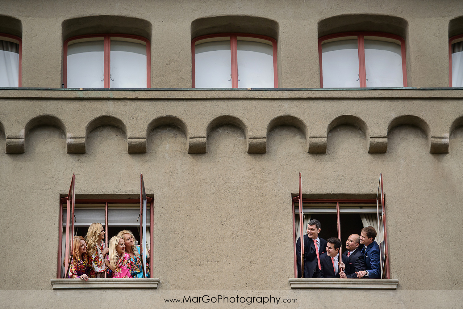 bridal party in the windows of Berkeley City Club