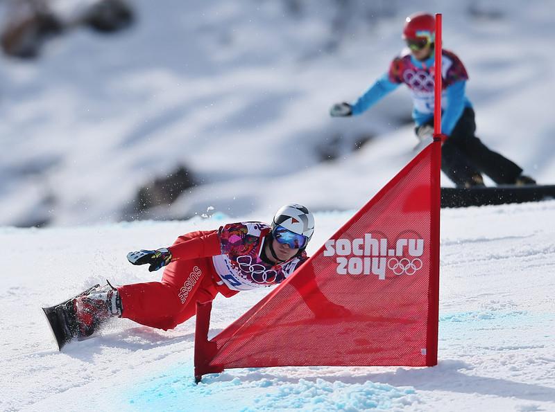 . Nevin Galmarini (red) of Switzerland leads Zan Kosir of Slovenia in the semi final of the men\'s Snowboard Parallel Giant Slalom at Rosa Khutor Extreme Park at the Sochi 2014 Olympic Games, Krasnaya Polyana, Russia, 19 February 2014.  EPA/SERGEY ILNITSKY