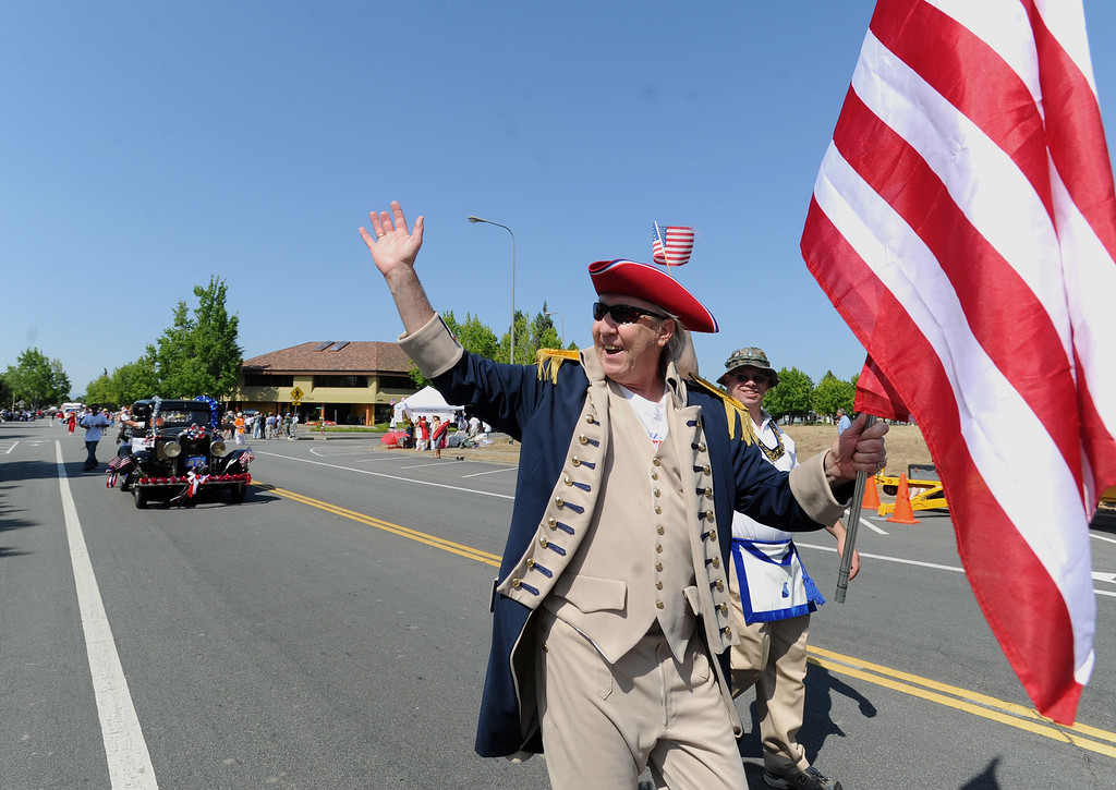 . Rick Hood, of Fremont, waves to the crowd as he participates in the Fourth of July parade in Fremont, Calif., on Thursday, July 4, 2013. The parade featured more than 70 entries. (Dan Honda/Bay Area News Group)
