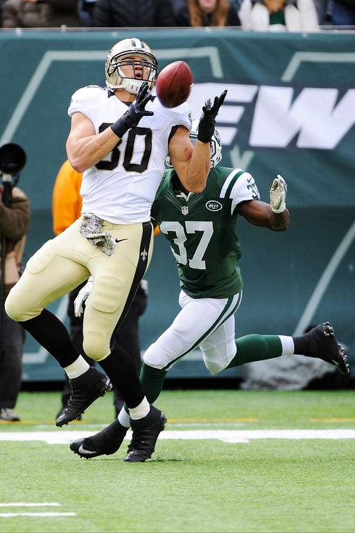. New Orleans Saints tight end Jimmy Graham (80) catches a pass in front of New York Jets free safety Jaiquawn Jarrett (37) during the first half of an NFL football game Sunday, Nov. 3, 2013, in East Rutherford, N.J. Graham scored a touchdown on the play. (AP Photo/Bill Kostroun)