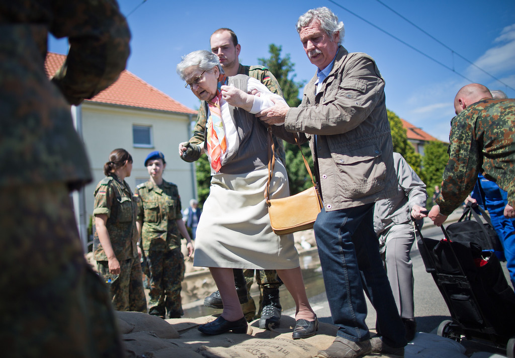 . Local residents are evacuated by soldiers of the rising floodwater of the River Elbe in Dresden, eastern Germany, on June 5, 2013. German Chancellor Angela Merkel pledged 100 million euros in emergency aid for flood-ravaged areas as surging waters that have claimed at least 11 lives and forced tens of thousands of evacuations across central Europe bore down on eastern Germany.  AFP PHOTO / MICHAEL KAPPELER  /AFP/Getty Images