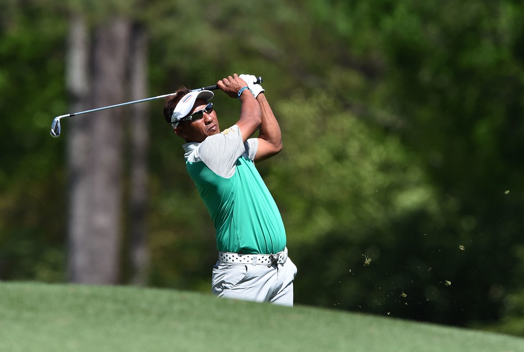 . Thailand\'s Thongchai Jaidee tees off on the 12th hole during Round 2 of the 80th Masters Golf Tournament at the Augusta National Golf Club on April 8, 2016, in Augusta, Georgia. / AFP PHOTO / DON  EMMERT/AFP/Getty Images