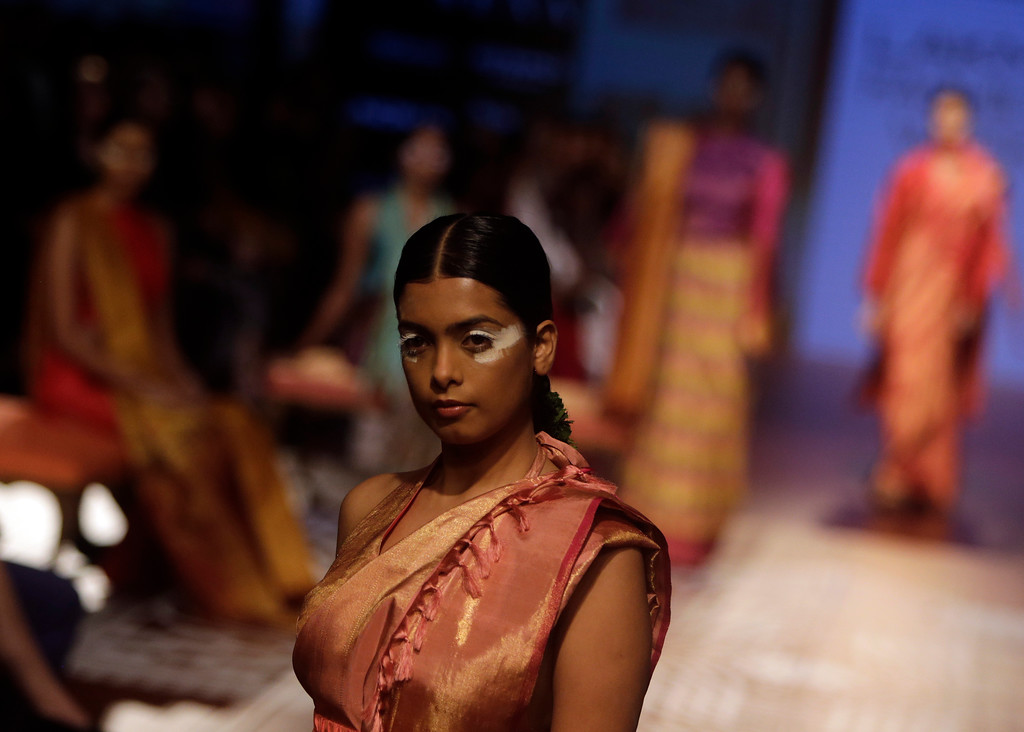 . A model walks the ramp to showcase the creation of designer Sunita Shanker during Lakme fashion week winter 2018 in Mumbai, India, Thursday, Aug. 23, 2018. (AP Photo/Rajanish Kakade)