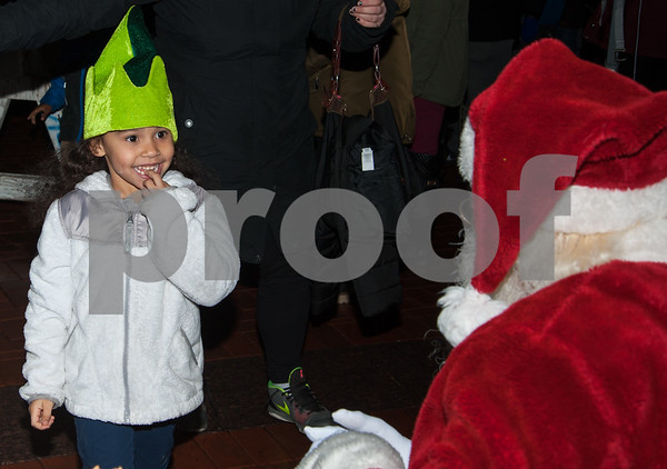 12/05/17 Wesley Bunnell | Staff New Britain held their annual Tree Lighting at Central Park on Tuesday evening with a visit from Santa Claus. Saphira Montgomer, age 5, smiles as she looks at Santa before giving him her Christmas wishes.