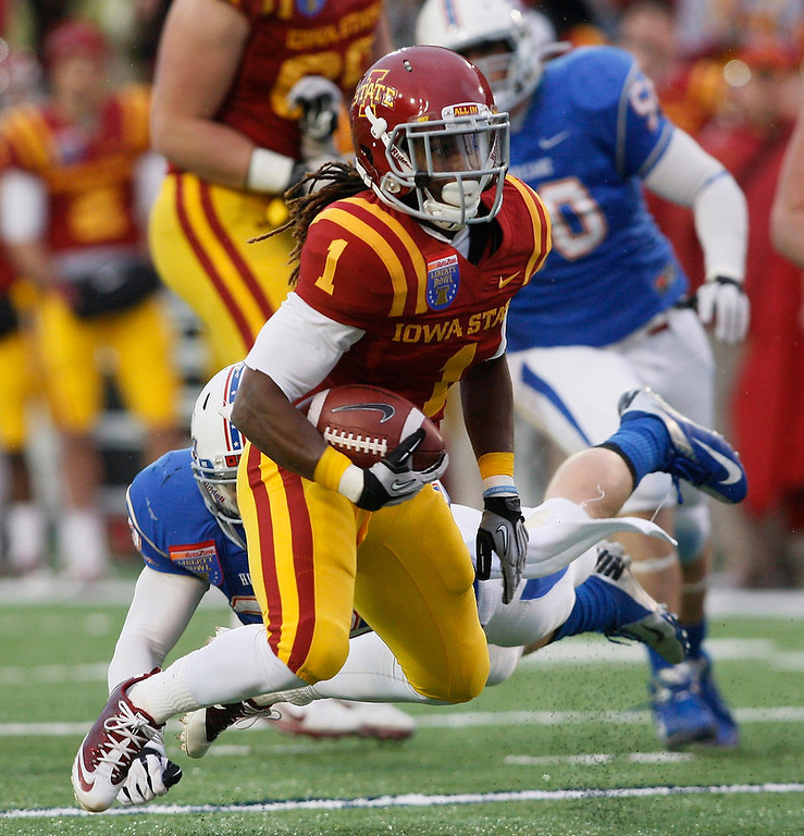 . Iowa State receiver Jarvis West looks for running room after hauling in a pass in the first quarter against Tulsa duringf the Liberty Bowl NCAA college football game in Memphis, Tenn., Monday, Dec. 31, 2012. (AP Photo/Charles A. Smith)