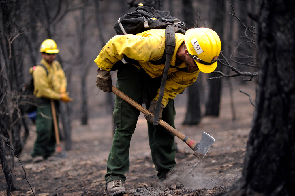 . Brian Kioclease, front, and firefighters from Kings Canyon, CA check hot spots near Cedar Heights Road from the Waldo Canyon Fire west of Colorado Springs, Colo., Friday, June 29, 2012. Hyoung Chang, The Denver Post