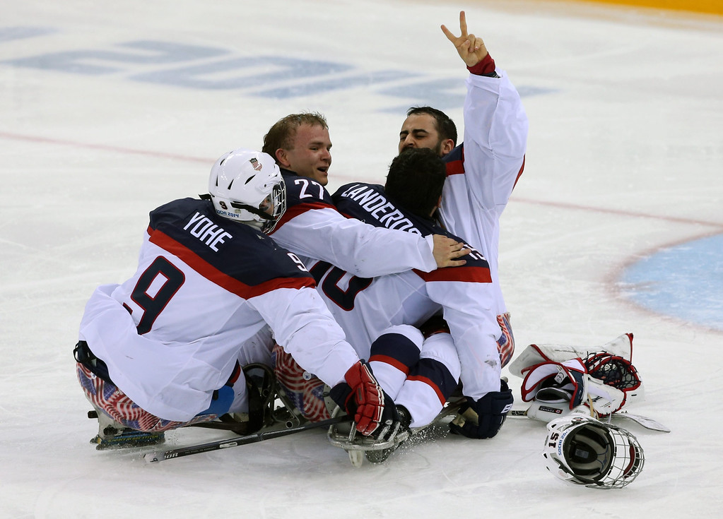 . US national team players celebrate their victory after the Ice Sledge Hockey final match Russia vs USA at Sochi 2014 Paralympic Games, Russia, 15 March 2014. USA took the first place.  EPA/SERGEI CHIRIKOV