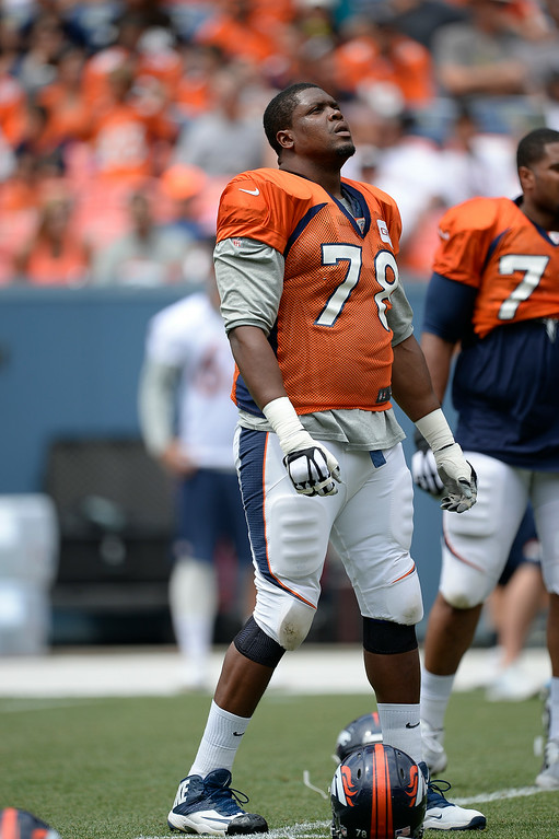 . Denver Broncos tackle Ryan Clady (78) stretches on day four of the Denver Broncos 2014 training camp July 27, 2014 at Sports Authority Field at Mile High. (Photo by John Leyba/The Denver Post)