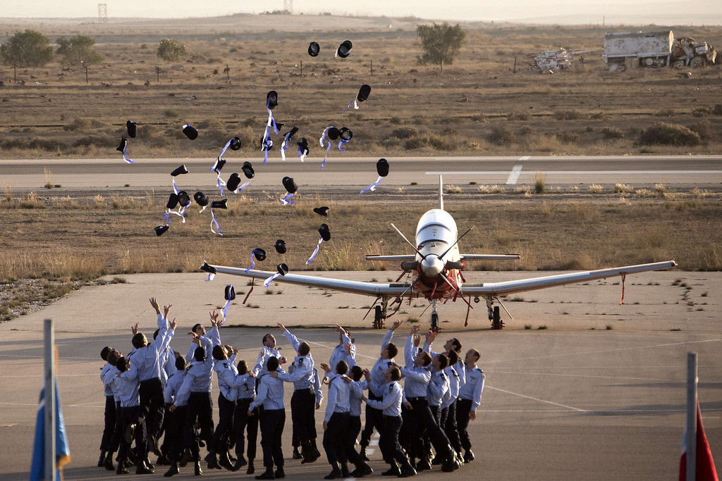 . Israeli air force pilots throw their hats in the air as they celebrate their graduation during a ceremony at the Hatzerim base in the Negev desert, near the southern Israeli city of Beersheva, on December 26, 2013. AFP PHOTO / JACK GUEZJACK GUEZ/AFP/Getty Images