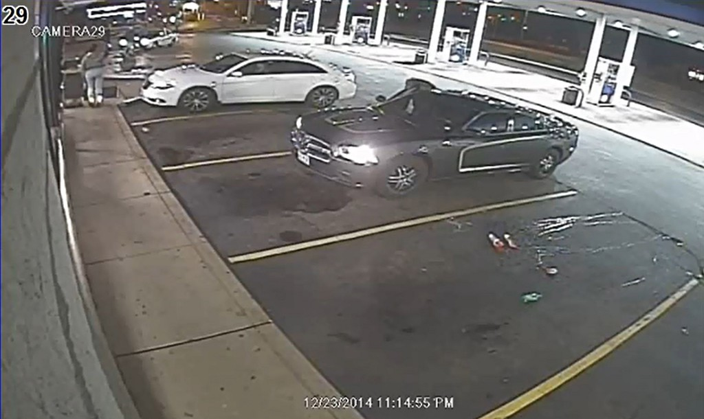 ". This surveillance video image provided December 24, 2014 by the St. Louis County Police in Missouri, shows moments Before Police Shooting(Near car upper left) in Berkeley, Missouri. A man was shot and killed by a police officer December 23 in Berkeley, Missouri, authorities said -- sparking new unrest in a region already reeling following an August police shooting a few miles away in Ferguson. The shooting happened at 11:15 p.m. CDT Tuesday at a Mobil gas station, St. Louis County Chief of Police Jon Belmar said in a morning news conference. Belmar said police visited the gas station when a report of a larceny came in. The victim, who is 18 years old, pointed a gun at the officer, sparking the deadly shooting, Belmar said.   AFP PHOTO / HANDOUT / ST. LOUIS COUNTY POLICE    == RESTRICTED TO EDITORIAL USE / MANDATORY CREDIT: ""AFP PHOTO / HANDOUT / ST. LOUIS COUNTY POLICE  \""/ NO MARKETING / NO ADVERTISING CAMPAIGNS / NO A LA CARTE SALES / DISTRIBUTED AS A SERVICE TO CLIENTS == --/AFP/Getty Images"