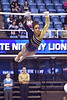 MORGANTOWN, WV - MARCH 8: WVU female gymnast Brooklyn Doggette competes on uneven bars during a dual meet March 8, 2015 in Morgantown, WV.
