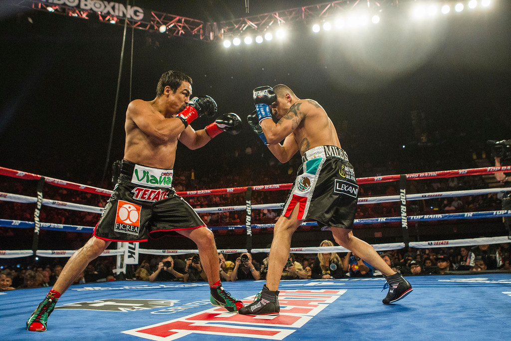 . Mike Alvarado, right, and Juan Manuel Márquez, of Mexico, exchange punches in the first round of a WBO welterweight title boxing match at the Forum in Inglewood, Calif., Saturday, May 17, 2014. Márquez won the title.  (AP Photo/Ringo H.W. Chiu)