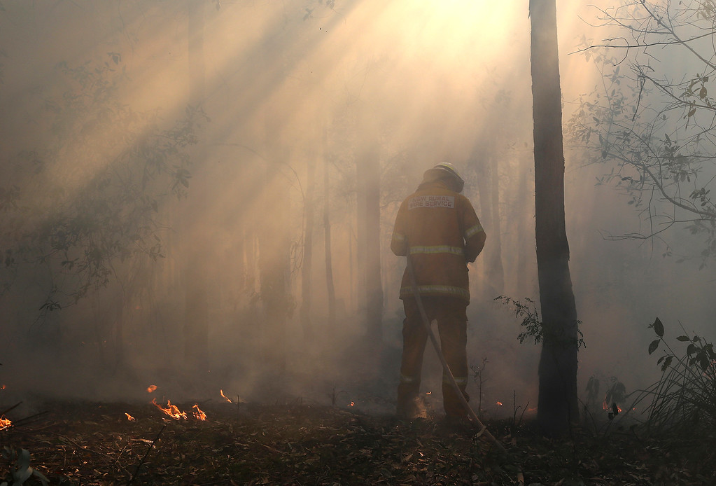 . A firefighter mops up after a firestorm swept through a property in Bilpin, 75 kilometers (47 miles) from Sydney, Wednesday, Oct. 23, 2013.  (AP Photo/Rob Griffith)