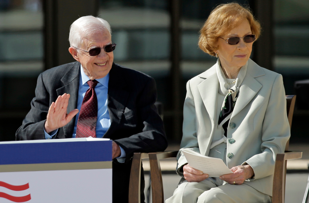 Description of . Former president Jimmy Carter and his wife, former first lady Rosalynn Carter arrive for the dedication of the George W. Bush Presidential Center, Thursday, April 25, 2013, in Dallas. (AP Photo/David J. Phillip)