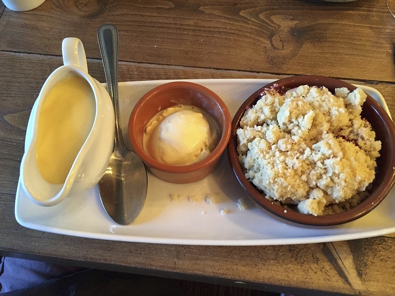A little crumble with ice cream and custard.