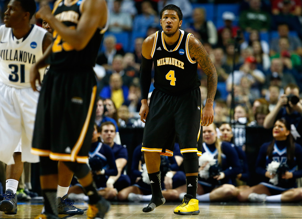 . BUFFALO, NY - MARCH 20: Malcolm Moore #4 of the Milwaukee Panthers plays defense after losing his shoe against the Villanova Wildcats during the second round of the 2014 NCAA Men\'s Basketball Tournament at the First Niagara Center on March 20, 2014 in Buffalo, New York.  (Photo by Jared Wickerham/Getty Images)