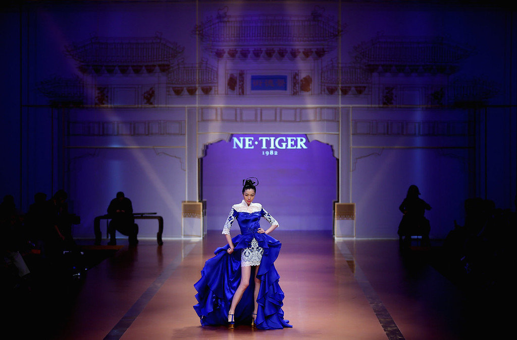 . A model showcases designs by Zhang Zhifeng on the runway at 2014 NE-TIGER Haute Couture Collection show during Mercedes-Benz China Fashion Week Spring/Summer 2014 at Beijing Hotel on October 25, 2013 in Beijing, China.  (Photo by Feng Li/Getty Images)