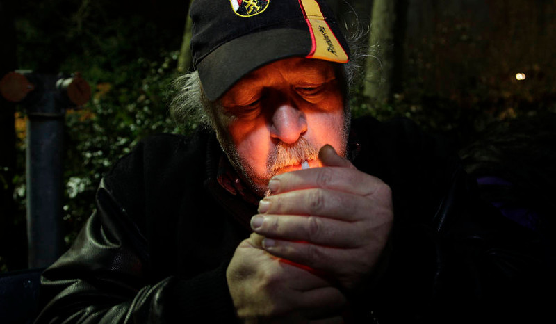 . Mike Momany smokes marijuana, Thursday, Dec. 6, 2012, just after midnight at the Space Needle in Seattle. Possession of marijuana became legal in Washington state at midnight, and several hundred people gathered at the Space Needle to smoke and celebrate the occasion, even though the new law does prohibit public use of marijuana. (AP Photo/Ted S. Warren)