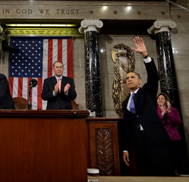 . President Barack Obama waves and House Speaker John Boehner of Ohio applauds after the president gave his State of the Union address during a joint session of Congress on Capitol Hill in Washington, Tuesday Feb. 12, 2013. (AP Photo/Charles Dharapak, Pool)