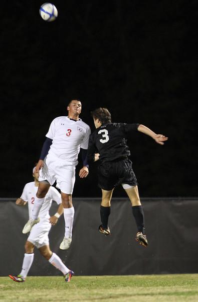 GWU's number 3, Matt Bogart, heads the ball.
