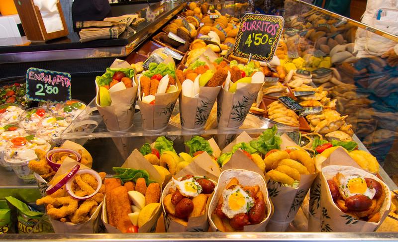 South American food stand inside La Boqueria market in Barcelona, Spain.