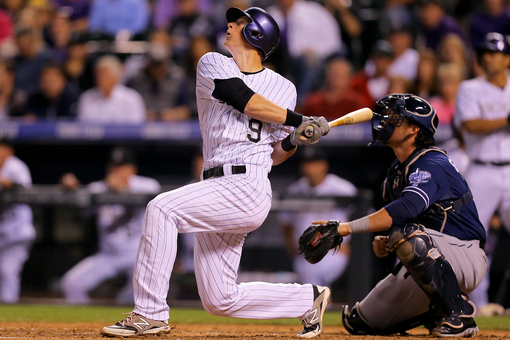 . DENVER, CO - SEPTEMBER 6:  DJ LeMahieu #9 of the Colorado Rockies watches his two RBI single during the fifth inning as catcher Yasmani Grandal #8 of the San Diego Padres looks on at Coors Field on September 6, 2014 in Denver, Colorado. (Photo by Justin Edmonds/Getty Images)