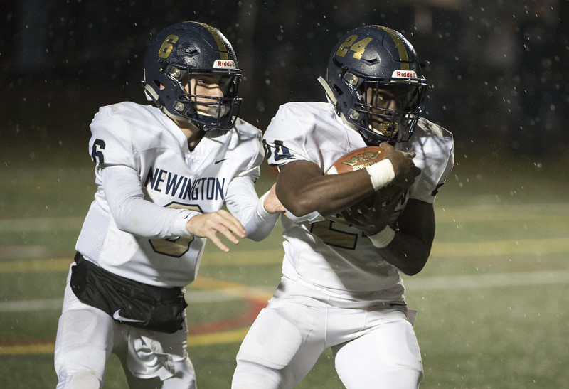 11/27/19  Wesley Bunnell | Staff  Newington football vs Wethersfield on Wednesday evening at Wethersfield High School.  QB Nicholas Pestrichello (6) hands off to RB John Amaning (24).