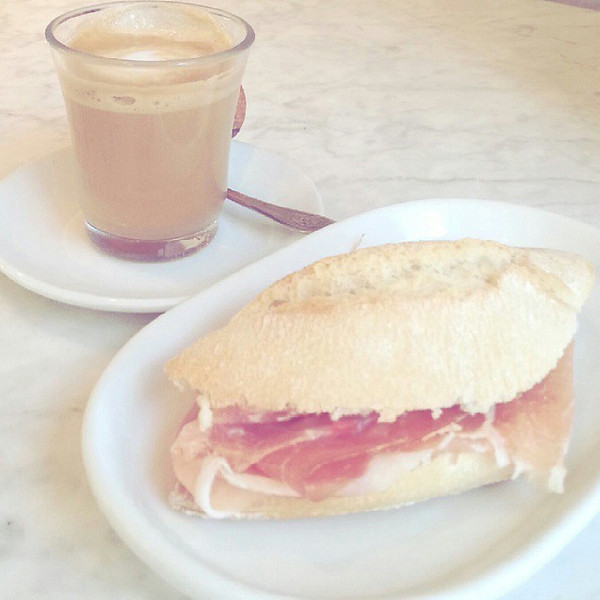 Starting_the_day_off_right_with_breakfast_in_Spain_mini_jam_n_bocadillo_and_caf__cortado..jpg