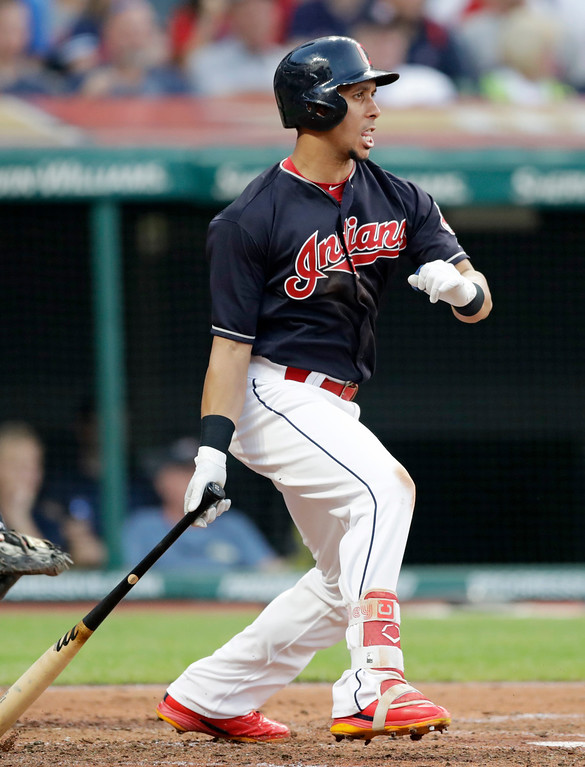 . Cleveland Indians\' Michael Brantley watches his two-run single off Cincinnati Reds relief pitcher Tanner Rainey during the third inning of a baseball game, Wednesday, July 11, 2018, in Cleveland. (AP Photo/Tony Dejak)